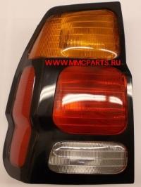 Фонарь левый (черная рамка, желтый поворот) паджеро cпорт 00-04 mb4044600l