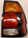Фонарь правый (черная рамка, желтый поворот) паджеро cпорт 00-04 mb4044600r